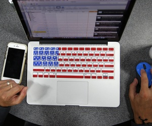 An attendee works on her computer during the Black Hat conference, Thursday, Aug. 6, 2015, in Las Vegas.
