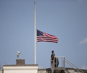 The American flag is flown at half staff over the White House in Washington, Sunday, June 12, 2016, after President Barack Obama spoke about the massacre at an Orlando nightclub.