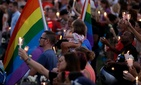 Tens of thousands attend a vigil for the Orlando shooting victims at Lake Eola, Sun., June 19.
