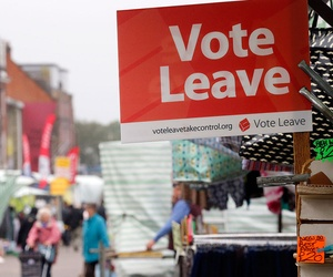 A Vote Leave sign is fixed on a market stall at Havering's Romford street market in London