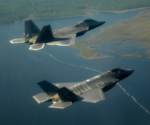 An Air Force F-22 Raptor (left) flies with an F-35 Joint Strike Fighter over Florida.