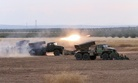 Syrian army rocket launchers fire near the village of Morek in Syria, Oct. 7, 2015. (AP photo)