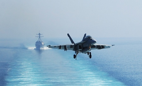 A U.S. Navy F/A-18F Super Hornet aircraft assigned to Strike Fighter Squadron (VFA) 213 prepares to land on the flight deck of the aircraft carrier USS George H.W. Bush (CVN 77), not shown, in the Persian Gulf Oct. 3, 2014.