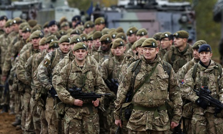 In this Nov. 13, 2014 file photo, British soldiers attend a military exercise 'Iron Sword 2014', at the Gaiziunu Training Range in Pabrade some 60km.(38 miles) north of the capital Vilnius, Lithuania.