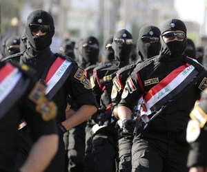 Iraqi security force members parade in Baghdad, Iraq, Thursday, July 14, 2016.