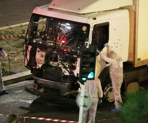 Authorities investigate a truck after it plowed through Bastille Day revelers in the French resort city of Nice, France, Thursday, July 14, 2016.