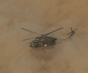 A U.S. Army UH-60 Black Hawk medevac helicopter conducts a limited visibility, or brownout, landing during medevac training in northern Iraq on July 3, 2016.