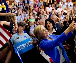Democratic presidential candidate Hillary Clinton takes a selfie with supporters in New Hampshire in July.