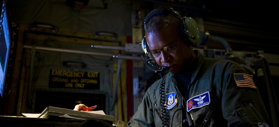 U.S. Air Force Master Sgt. Vince Burden, annotates the serial number of a dropsonde on board a WC-130J Super Hercules aircraft over the Atlantic Ocean Sept. 17, 2010.