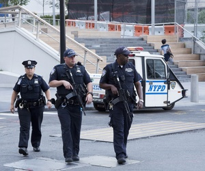 Port Authority police officers patrol the World Trade Center, Monday, Aug. 15, 2016, in New York.