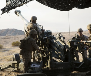 Marines prepare to fire an M777A2 howitzer during an excercise at the at Marine Corps Air-Ground Combat Center Twentynine Palms, Calif., Aug. 16, 2016.