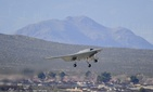 An X-47B Unmanned Combat Air System Demonstrator (UCAS-D) completes its first flight at Edwards Air Force Base, Calif., Feb. 4, 2011.
