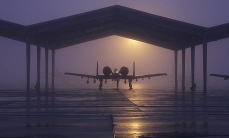 An A-10 Thunderbolt II from the 127th Wing is parked beneath a shelter on a foggy morning Jan. 11, 2014, at Selfridge Air National Guard Base, Mich