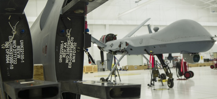 An MQ-9 Reaper sits in a hangar prior to having the wings put on at Holloman Air Force Base, Oct. 13, 2015.