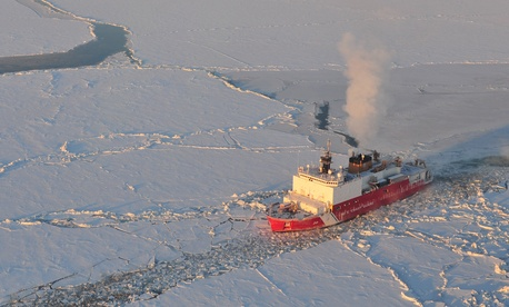 In this 2006 file photo, the U.S. Coast Guard cutter Healy breaks ice for the Russian tanker Renda near Nome, Alaska.