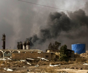 Oil wells on the edge of the Iraqi town Qaraya burned days after the key town south of was retaken from the Islamic State