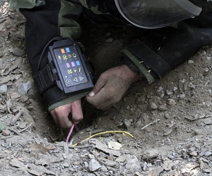 An Afghan soldier defuses IEDs at a training exercise in Jalalabad, east of Kabul, Afghanistan, Aug. 27, 2013.