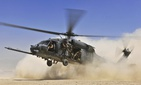A U.S. Air Force HH-60G Pave Hawk helicopter carrying combat search and rescue Airmen approaches a landing zone during an exercise Aug. 21, 2010, at Bagram Airfield, Afghanistan.
