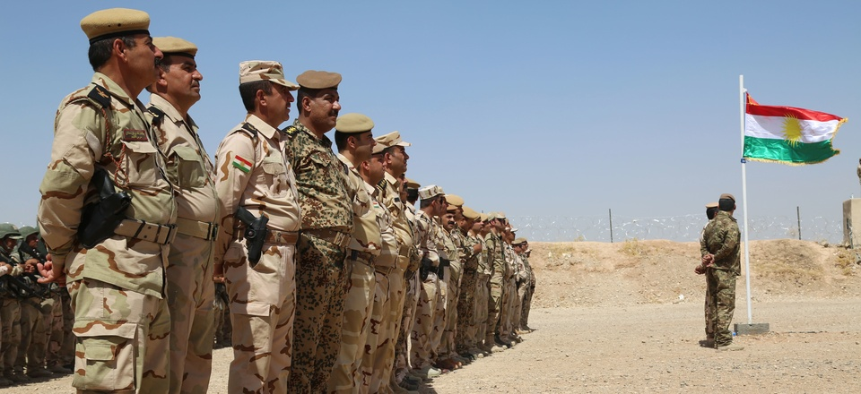 Peshmerga troops stand in formation during the Modern Brigade Course 2 graduation ceremony at the Menila Training Center, Iraq, July 28, 2016.