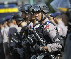 Indonesian police officers deploy with their riot gear in Jakarta, Indonesia, Wednesday, Dec. 23, 2015.