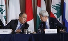 Russia's Foreign Minister Sergey Lavrov, left, and United States Secretary of State John Kerry talk during a meeting of the International Syria Support Group, Sept. 22, 2016, in New York.
