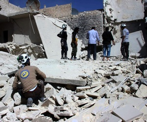 Members of Civil Defense inspecting damaged buildings after airstrikes hit the Bustan al-Qasr neighborhood of Aleppo, Syria, Sunday, Sept. 25, 2016.