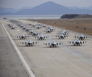 "F-16 Fighting Falcons demonstrate an ""elephant walk"" formation as they taxi down a runway during an exercise at Kunsan Air Base, South Korea, on Dec. 2, 2011."