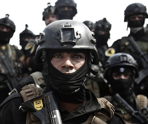 A soldier from the 1st Battalion of the Iraqi Special Operations Forces listens to an address by his commander after a training exercise to prepare for the operation to re-take Mosul from Islamic State militants.
