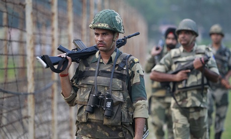 Indian Border Security Force soldiers patrol the India-Pakistan border area at Ranbir Singh Pura, about 35 kilometers (22 miles) from Jammu, India, Saturday, Sept. 24, 2016.