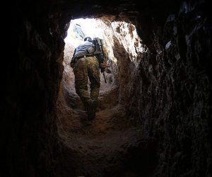 A peshmerga fighter walks through a tunnel made by Islamic State fighters, Tuesday, Oct. 18, 2016.