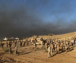 Iraqi army soldiers wait for an attack to begin against the Islamic State group of Mosul on Thursday.