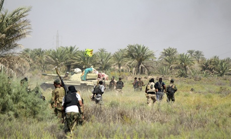 Iraqi security forces backed by allied Shiite Popular Mobilization forces and Sunni tribal fighters prepare to attack Islamic State positions at Khalidiya Island in Anbar province, Iraq, Monday, Aug. 1, 2016.