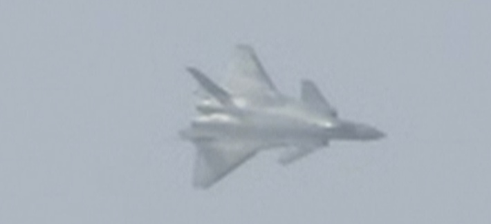 In this image made from video, the J-20 stealth fighter jet flies at the China's International Aviation and Aerospace Exhibition in Zhuhai on Nov. 1, 2016.