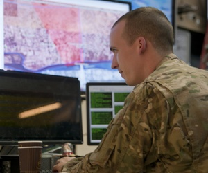A U.S. Army officer watches his monitor for updates from clearance operations in Ramadi, Iraq from the Combined Joint Operations Command (CJOC) in Baghdad, Iraq Dec. 30, 2015.