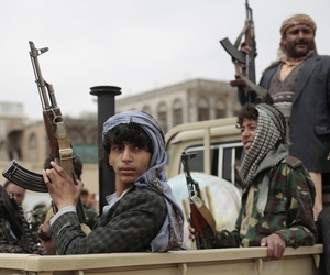 Tribesmen loyal to Houthi rebels hold their weapons as they ride on the back of a truck during a gathering aimed at mobilizing more fighters into battlefronts in several Yemeni cities, in Sanaa, Yemen, Thursday, Nov. 10, 2016.