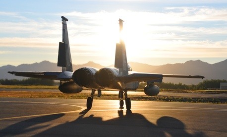 A U.S. Air Force F-15C Eagle fighter aircraft from the 104th Fighter Wing, Massachusetts Air National Guard, departs Joint Base Elmendorf-Richardson, Alaska, for Barnes Air National Guard Base, Mass., on Aug. 12, 2011.