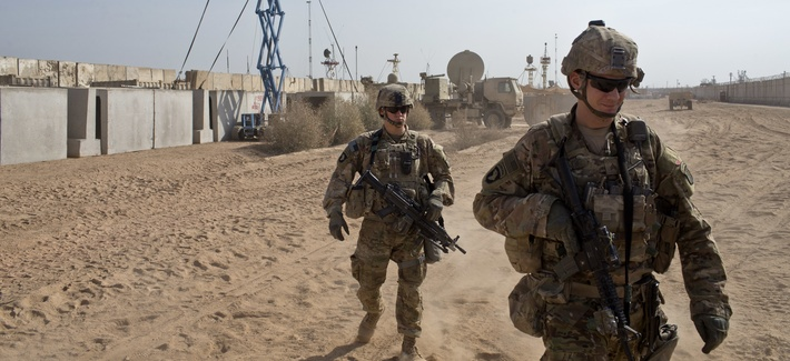 U.S. Army soldiers move through Qayara West Coalition base in Qayara, some 50 kilometers south of Mosul, Iraq, Wednesday, Nov. 9, 2016. Kurdish peshmerga forces continued their push on the town of Bashiqa, some 13 kilometers (8 miles) northeast of Mosul.