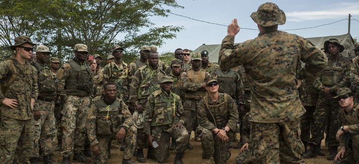 Lance Cpl. Jackson Clark, teaches a class about how to load and operate the M32 grenade launcher during Exercise Tradewinds 2016 in Jamaica. Tradewinds  focuses on increasing regional cooperation in complex multinational security operations.