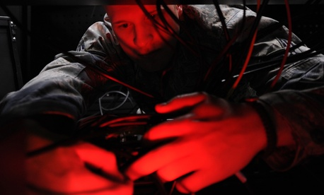An Airman installs computer systems on the operations floor of the new 497th Intelligence, Surveillance, and Reconnaissance Group building at Langley Air Force Base, Va., April 21, 2010.