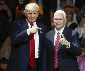 President-elect Donald Trump, left, and Vice President-elect Mike Pence acknowledge the crowd during the first stop of his post-election tour, Thursday, Dec. 1, 2016, in Cincinnati.