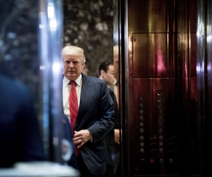 President-elect Donald Trump boards an elevator after speaking with the media at Trump Tower in New York, Tuesday, Dec. 6, 2016.