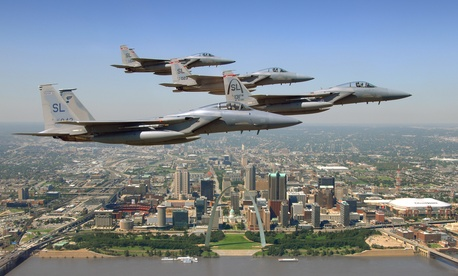 Four St. Louis-built F-15 Eagles fly past the city's downtown area in a 2008 photo.