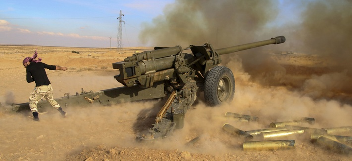 Syrian government troops fire at Islamic State group positions near Mahin, Syria, Jan. 30, 2016.