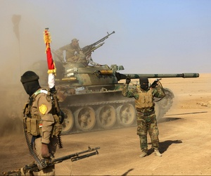Fighters of the Popular Mobilization Forces at the front line against Islamic State Group militants outside Mosul, Iraq, in November.