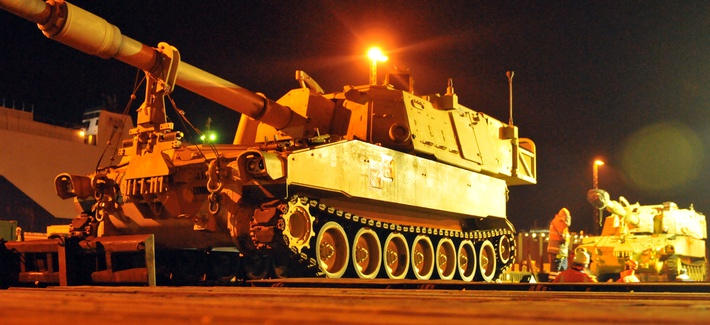 An Army M109A6 Paladin, sitting on a railhead in Germany Jan. 6, waiting to be transported to Poland.