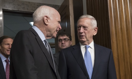 Senate Armed Services Committee Chairman Sen. John McCain, R-Ariz., left, welcomes Defense Secretary-designate James Mattis on Capitol Hill in Washington, Thursday, Jan. 12, 2017.