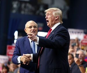 Then-Republican presidential candidate Donald Trump with his now-named cybersecurity advisor Rudy Giuliani at a campaign rally in Ohio in the summer of 2016.