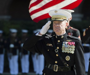 U.S. Marine Corps Gen. James F. Amos, the outgoing commandant of the Marine Corps, salutes during a change of command and retirement ceremony at Marine Barracks Washington in Washington, D.C., Oct. 17, 2014.