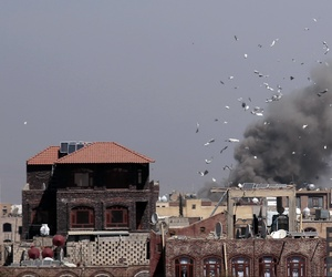 Debris and smoke rise after a Saudi-led airstrike hit an army base, in Sanaa, Yemen, on Jan. 22, 2017.