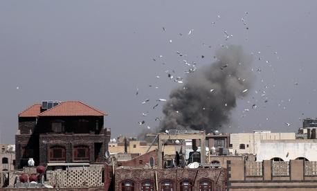 Debris and smoke rise after a Saudi-led airstrike hit an army base, in Sanaa, Yemen, on Jan. 22, 2017.